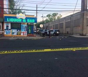 Police canvasing the scene of a shooting in Trenton, N.J. on Saturday, May 25, 2019. (3 CBS Philadelphia via AP)