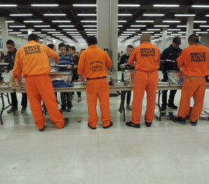 Inmates from Central New Mexico Correctional Facility serve the homeless during the annual Joy Junction Thanksgiving meal in 2015. Last month, the facility was rocked by two inmate suicides within 24 hours.