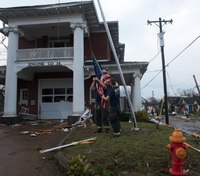 Photo of the Week: Nashville firefighters tend to flag outside damaged station