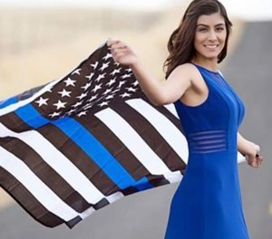 Natalie Corona waving the thin blue line flag