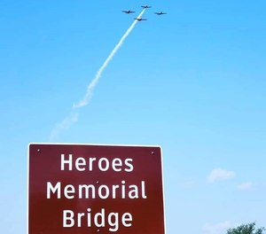 This sign shows the new name for Heroes Memorial Bridge.