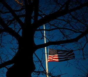 In memory of the victims at Sandy Hook, the flag is half-staff.