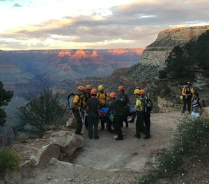 The sunset colors disappearing on the terrain behind our litter team taking a break during a carry out on the Bright Angel Trail.  (Photo/Courtesy of the National Park Service)