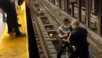 Watch: With seconds to spare, NYPD cop pulls man from subway tracks