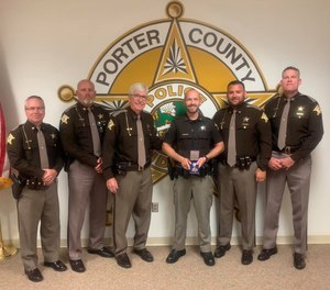 Instead of facing charges in an OIS, thanks to bodycam footage, the officer at the center of the incident was given the Officer of the Year award for saving the lives of his fellow officers. (image/Porter County Sheriff's Office)