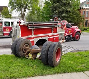 The engine's rear axle separated from the apparatus while en route to a call.