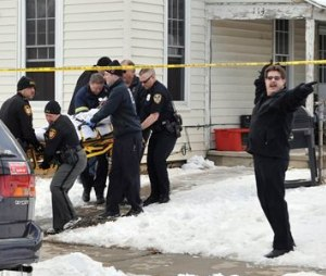 Emergency personnel carry a person out on a stretcher from a home in Troy, Ohio on Friday, Feb. 27, 2015. Two teenage sisters died and two other children were hospitalized after a relative found all four unresponsive from a suspected carbon monoxide leak in the house, officials said. (AP Photo/Piqua Daily Call, Mike Ullery)
