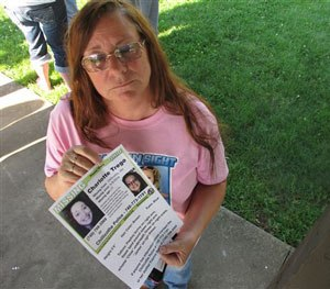 In this June 24, 2015, photo, Yvonne Boggs holds a flier seeking information on her daughter, Charlotte Trego, who has been missing for more than a year, in Chillicothe, Ohio. (AP Image)
