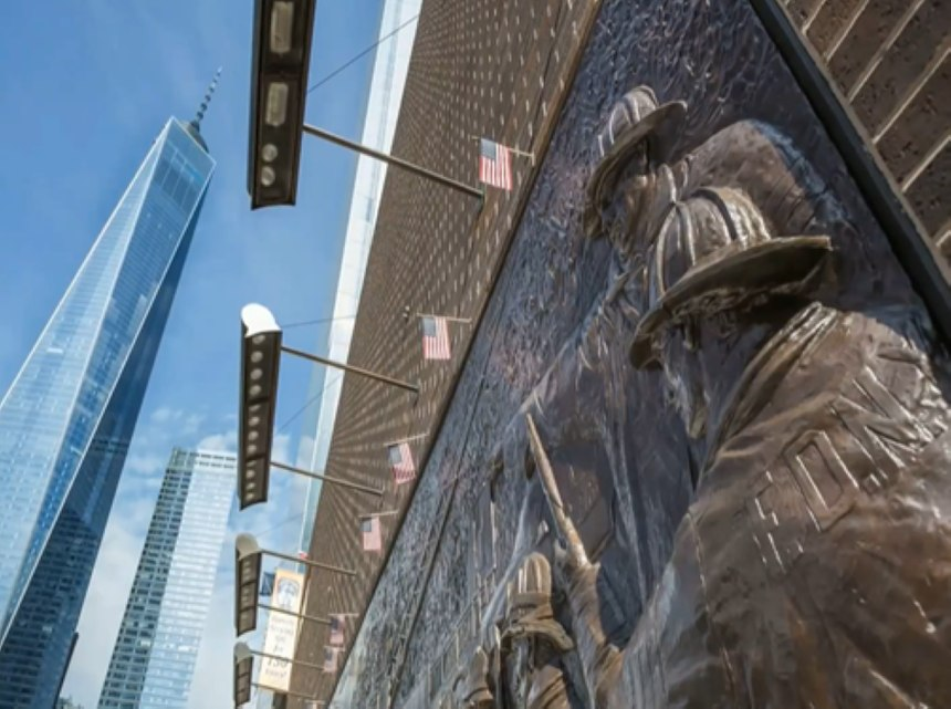A view of One World Trade Center from a firefighter memorial in New York City.