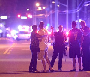A gunman killed 49 people and injured dozes more at the Pulse Orlando nightclub. (AP Photo/Phelan M. Ebenhack)