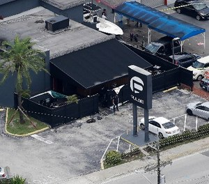 In this June 12, 2016 file photo, law enforcement officials work at the Pulse gay nightclub in Orlando, Fla., following the a mass shooting. (AP Photo/Chris O'Meara, File)