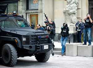 Officers next to a BearCat during the Ottawa Parliament shooting, October 2014 (Image/AP)