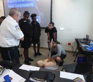 Training coordinators broke the cadets into teams to teach hands-on instructions on resuscitation and blood loss prevention.(Photo/Armstrong Ambulance)