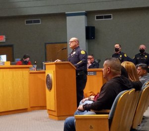 Then-assistant police chief Manny Morales speaks at a Miami city meeting on Oct. 1, 2021.