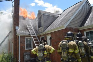 Maryland firefighters work to extinguish a house fire that injured one firefighter. (Mark E. Brady, PGFD PIO)