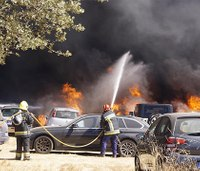 Video: Massive parking lot fire destroys over 400 vehicles