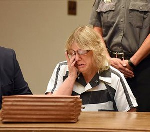 Joyce Mitchell cries as she sits with her attorney Stephen Johnston in court on Tuesday July 28, 2015 in Plattsburgh, N.Y.