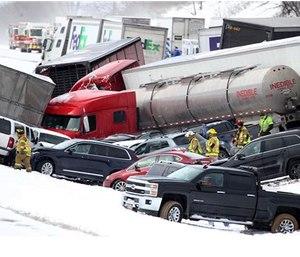 Emergency personnel work at the scene of a fatal crash near Fredericksburg, Pa., Saturday. (Daniel Zampogna/PennLive.com via AP)