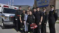 Grade school student made an honorary paramedic