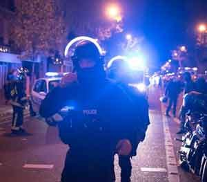 Elite police officers arrive outside the Bataclan theater in Paris, France. French President Francois Hollande saidhas closed the country's borders and declaring a state of emergency.