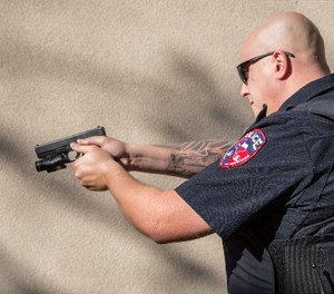 """The bill would """"encourage prosecutors to consider whether officers could have de-escalated a situation with verbal warnings or used nonlethal force"""" before resorting to gunfire. (Photo/PoliceOne)"""