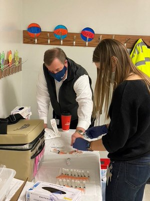 Todd Baker of Advanced Medical Transport and epidemiologist Kate Endress of the Peoria City and County Health Department prepare Moderna COVID-19 vaccine doses for administration. (Photo/Josh Bradshaw)