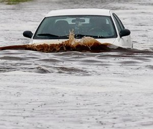 Storms that flooded several Phoenix-area freeways and numerous local streets during the Monday morning commute set an all-time record for rainfall in Phoenix in a single day. (AP Photo/Ross D. Franklin)