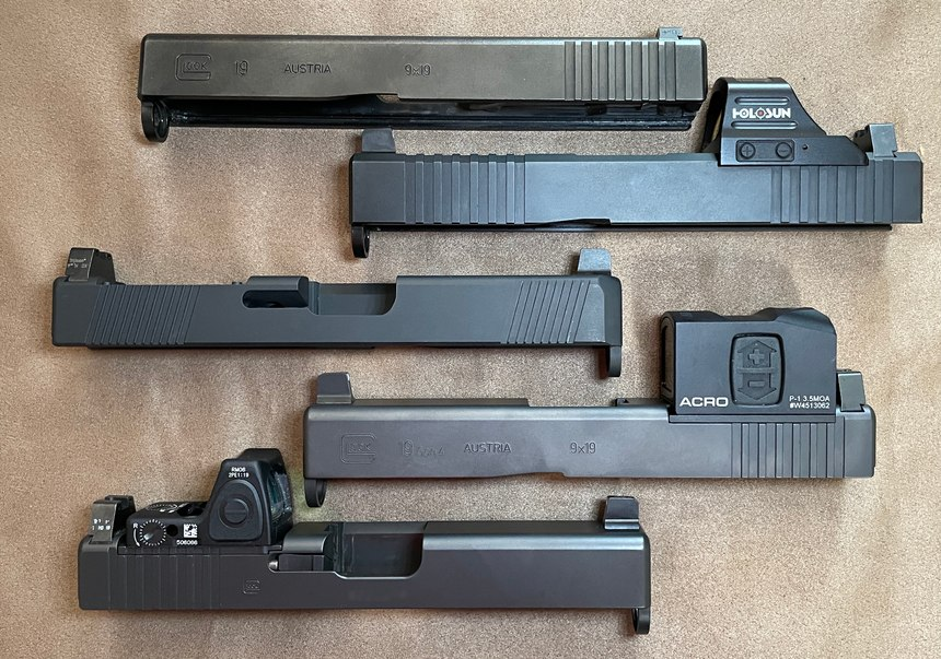 Top to bottom: Factory Gen 3 slide, Brownells slide with RMR cut, Swenson slide with a Vortex Viper cut, Gen 4 MOS with Aimpoint plate, Gen 4 MOS with Glock RMR plate. Note the suppressor-height sights that allow co-witnessing of the RDS. (Photo/Ron LaPedis)
