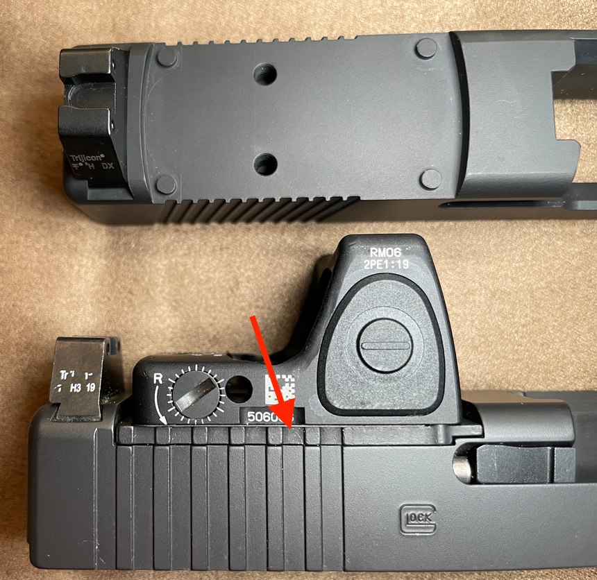 Top: Swenson Glock Gen 3 slide with Vortex Venom cut. Note the bosses that fit into the base of the RDS to take the G forces. Bottom: Glock Gen 4 slide with a Glock MOS plate (arrow). (Photo/Ron LaPedis)