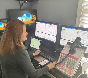 When remote dispatch went live, Arlington's fire dispatcher at home had another fire dispatcher sitting in the ECC – just in case there was a disconnect, the ECC dispatcher could instantaneously take over. (Photo/Arlington County Emergency Communications Center)