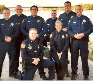 The author (kneeling) is pictured here with the last group of officers he helped field train before retiring.