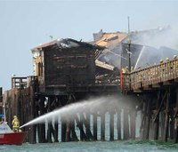 Flames tear through former restaurant on Calif. pier