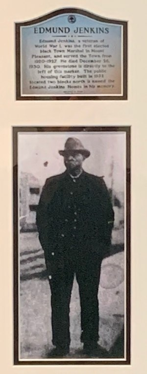 A plaque and photo honor Edmund Jenkins, the first Black police officer in Mount Pleasant, South Carolina.