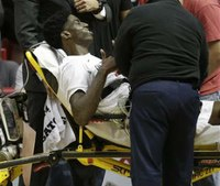 College basketball player collapses during game