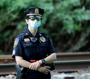Public safety personnel respond to survey on department face mask policy, face mask use and face mask opinions during the COVID-19 pandemic. (AP Photo/Frank Franklin II)