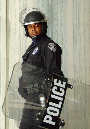 Police officer in riot gear (Photo/Wikimedia Commons)