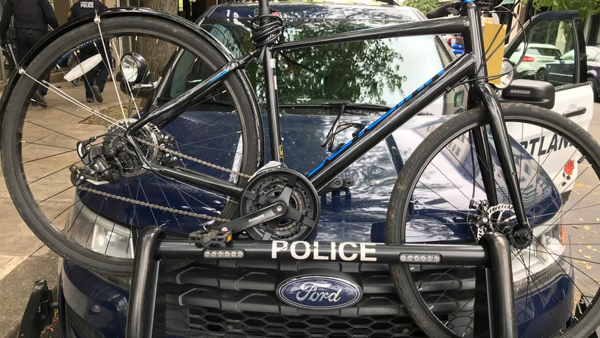 Without a purpose-built rack, transporting a bicycle could significantly obstruct the officer's view while driving.