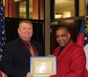 Sgt. Greg Meagher, left, receiving recognition for 30 years of distinguished service. (Photo/Richmond County Sheriff)