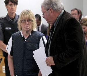Joyce Mitchell stands with her lawyer Steven Johnston, appearing before Judge Buck Rogers in Plattsburgh City Court, New York, for a hearing Monday June 15, 2015.