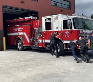 On May 25, 13firefighters andWoodlandCity AdministratorPete Boycepushed the 38,000 pound new engine into theScott Avenuestation's bay without the motor on, as part of the department's tradition.