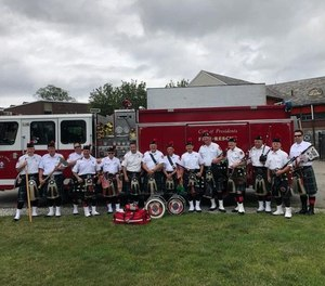 Members of the Greater Boston Firefighters Pipes and Drums who helped save a man's life on Saturday.