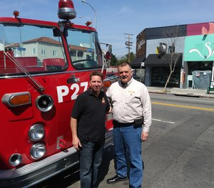 Jesse Quinalty (left) and John Salka, FDNY battalion chief (ret.), ride around Los Angeles in a 1972 Crown Firecoach.