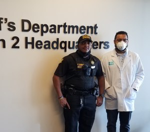 Pictured are Deputy Deandre Jennings following his test, and Mr. Kevin Bland, project director of Rapid Reliable Testing.