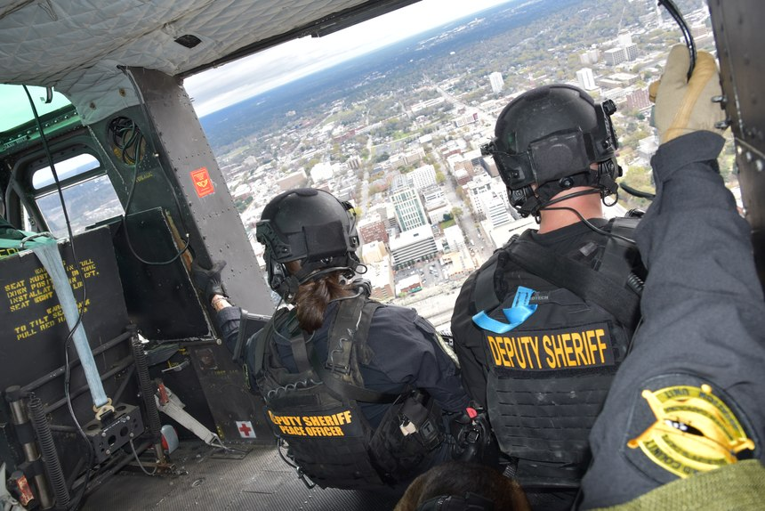 SRT operators during a flight aboard RCSD's UH-1H helicopter over Columbia, S.C., March 19.