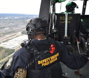 SRT operator and RCSD Aviation Unit co-pilot during a flight aboard RCSD's UH-1H helicopter over Columbia, S.C., March 19.