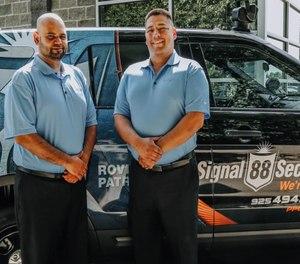 Roger Estrada (right) operates a successful business enterprise.