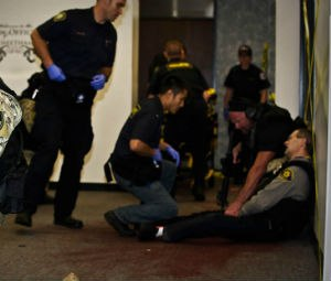Rescue Task Force medics treat a victim at the point of wounding during an Urban Shield scenario.