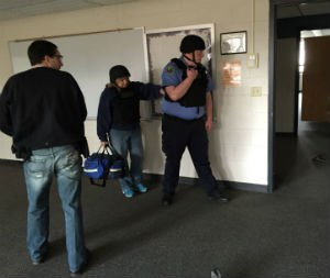 Medics and police officers practice the rescue task force method for finding and treating patients in the warm zone during an active-shooter incident.