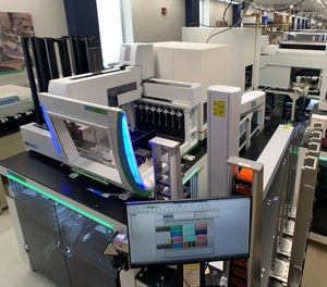 A fully automated nucleic acid extraction workstation at Rutgers' RUCDR Infinite Biologics can process up to 10,000 saliva samples per day for SARS-CoV-2 coronavirus testing.