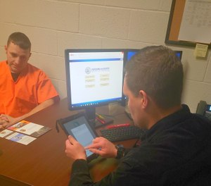 A jail release coordinator using a custom data portal to connect an offender to treatment and other services upon release. The portal connects the criminal justice system's law enforcement and service providers and allows for data sharing and recidivism tracking. (Photo/Yavapai County Sheriff)